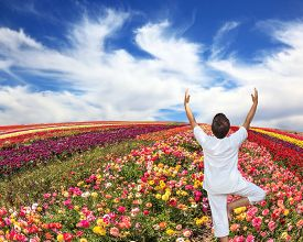 pic of buttercup  - An woman dressed in white doing yoga pose  - JPG