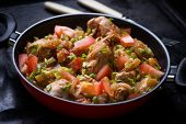 picture of dark side  - Chicken stew with onion pepper ant tomato selective focus dark background - JPG