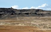 pic of plateau  - Dry landscape filled with sand dunes and dirt under the plateau which is the highest point in the islet of Djeu in Cabo Verde - JPG