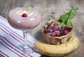 picture of banana  - Smoothie of banana frozen raspberries and rhubarb with yogurt in a glass - JPG