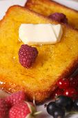 foto of french-toast  - Fried French toast with syrup and fresh berries macro on a plate - JPG