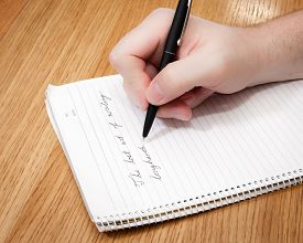 stock photo of cursive  - Cursive writing is demonstrated by writing  - JPG