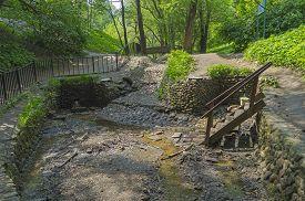 stock photo of ravines  - The stream and springs in the Golosov ravine in Kolomenskoye park in Moscow - JPG