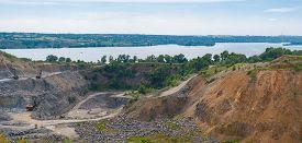 stock photo of feldspar  - Quarry beside big river Dnepr near Dnepropetrovsk city Ukraine - JPG