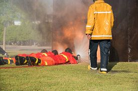 stock photo of firemen  - fireman at fire fighter training they training for spray water to the fire - JPG