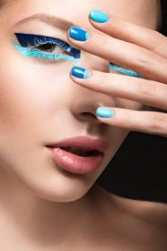 picture of nail paint  - Beautiful girl with bright creative fashion makeup and blue nail polish - JPG