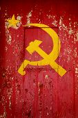 stock photo of communist symbol  - Communist Party symbol in a old wooden door with red paint peeling - JPG