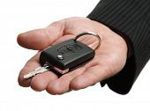 stock photo of car key  - Car salesman or rental man giving a car key to someone - JPG