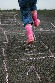 foto of hopscotch  - Girl Playing Hopscotch - JPG