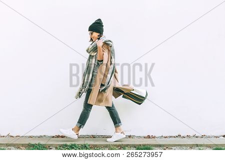 poster of Woman In Trend Multilayered Outfit Walks In Autumn City Street. Fashion Street Trends