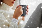 hot drinks and people concept - close up of girl in winter sweater with cacao mug sitting at home wi poster
