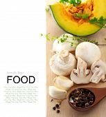stock photo of crimini mushroom  - Mushrooms and kabocha pumpkin with spices and herbs on cutting board - JPG