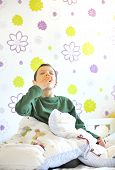 stock photo of little boy  - boy awakening in his bed in morning time - JPG