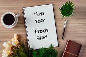 Notepad With Wish List And Coffee Cup. New Years Hope And Resolution Concept - New Year, Fresh Star poster