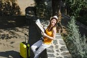 Young Cheerful Traveler Tourist Woman In Yellow Summer Casual Clothes Hat With Suitcase Holding City poster