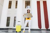 Cheerful Traveler Tourist Woman In Yellow Summer Casual Clothes Hat With Suitcase Looking On City Ma poster