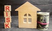 Miniature Wooden House, Dollars And The Inscription  Risk . Buying A House, Apartment And Financia poster