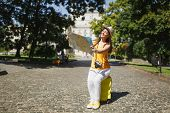 Smiling Traveler Tourist Woman In Yellow Clothes Hat Sit On Suitcase Looking On City Map Search Rout poster