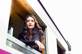 Charming Beautiful Woman Is Looking And Admiring Beautiful View During Retro Train Running And Takin poster