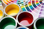 Paint Cans And Color Palette Samples On Table, Closeup poster