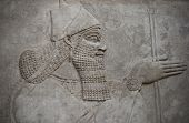 stock photo of sumerian  - Head of an ancient assyrian warrior carved in stone - JPG