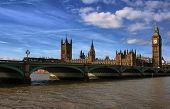 The Big Ben,the Houses of Parliament and Westminster bridge in London in a clear day with a dramatic