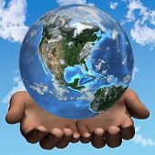 pic of world-globe  - Hands hold planet Earth on a sky cloud background - JPG