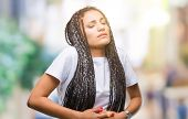 Young braided hair african american girl over isolated background with hand on stomach because indig poster