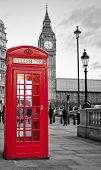 stock photo of monochromatic  - A  traditional red phone booth in London with the Big Ben in a black and white background - JPG