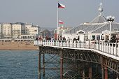 BRIGHTON,UK-MARCH 31:Visitors at the pier March 31,2011 in Brighton.Finished in 1899 and occupied by