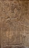 image of babylonia  - Ancient assyrian clay relief depicting a warrior with a sword and text written in cuneiform writing - JPG