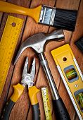 Set of manual  tools on a wooden boards background