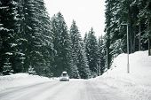 Car Driving On A Winter Road In The Mountains poster