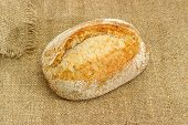 Whole Oval Loaf Of The Brown Wheat And Rye Bread With Added Whole Sprouted Wheat Grains, Rye Leaven, poster