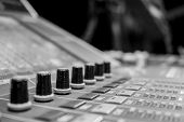 Professional Audio Mixing Board/ Console And A Row Of Digital Audio Encoders poster