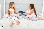 Sisters Rivalry Concept. Sisters Relations Issues. Share Book With Friend. Children In Bedroom Want  poster