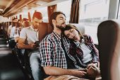 Young Smiling Couple Traveling On Tourist Bus. Handsome Man And Beautiful Woman Relaxing On Passenge poster