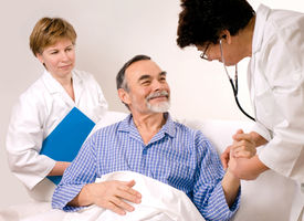 stock photo of medical assistant  - A doctor and a nurse with patient - JPG
