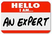picture of soliciting  - The words Hello I Am An Expert written on a red nametag or sticker for a consultant or other business professional to wear and solicit new clients and business for his firm or practice - JPG