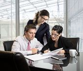 picture of business meetings  - Young businesspeople on a meeting at office - JPG