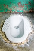 stock photo of septic  - Ceramic lavatory with septic tanks on cement floor - JPG