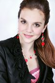 foto of gangster necklace  - Portrait of a young girl in earrings and a necklace of coral - JPG