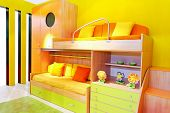 stock photo of bunk-bed  - Interior of yellow kids room with bunk beds - JPG