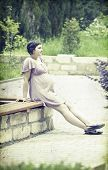 stock photo of clary  - Vintage photo of pregnant woman relaxing in the park - JPG