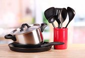 stock photo of food preparation tools equipment  - kitchen tools on table in kitchen - JPG