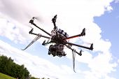 foto of helicopter  - A photography multirotor helicopter with SLR camera attached - JPG