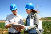 image of turbines  - Engineers using tablet on wind turbine site - JPG