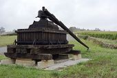 pic of wine-press  - Old wooden wine press in Tuscany - JPG