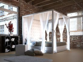 picture of canopy  - White canopy bed in a loft with brick wall - JPG
