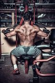 stock photo of muscle builder  - body builder doing heavy weight exercise for back - JPG